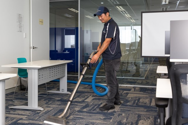 PetraClean cleaner vacuuming office carpet